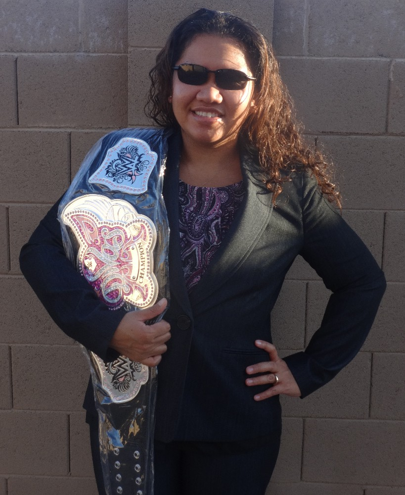 picture of sehana with wwe diva's belt over her shoulder